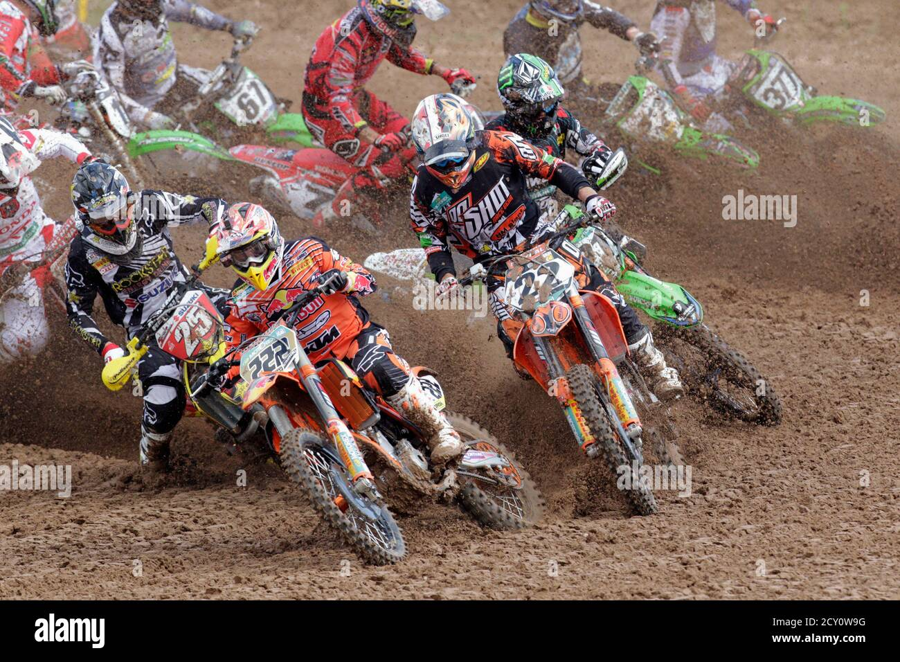 Clement Desalle of Belgium (front L to R), Antonio Cairoli of Italy and Kevin Strijbos of Belgium compete during MX1 FIM motocross World Championship event in Kegums July 15, 2012. REUTERS/Ints Kalnins (LATVIA) Stock Photo