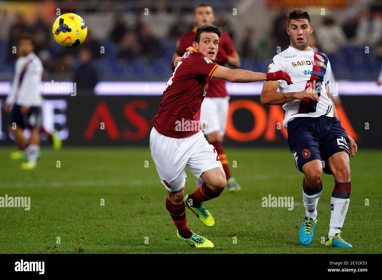 AS Roma's Alessandro Florenzi (L) and Cagliari's Nicola Murru fight for the ball during their Italian Serie A soccer match at the Olympic stadium in Rome November 25, 2013.  REUTERS/Giampiero Sposito (ITALY - Tags: SPORT SOCCER) Stock Photo