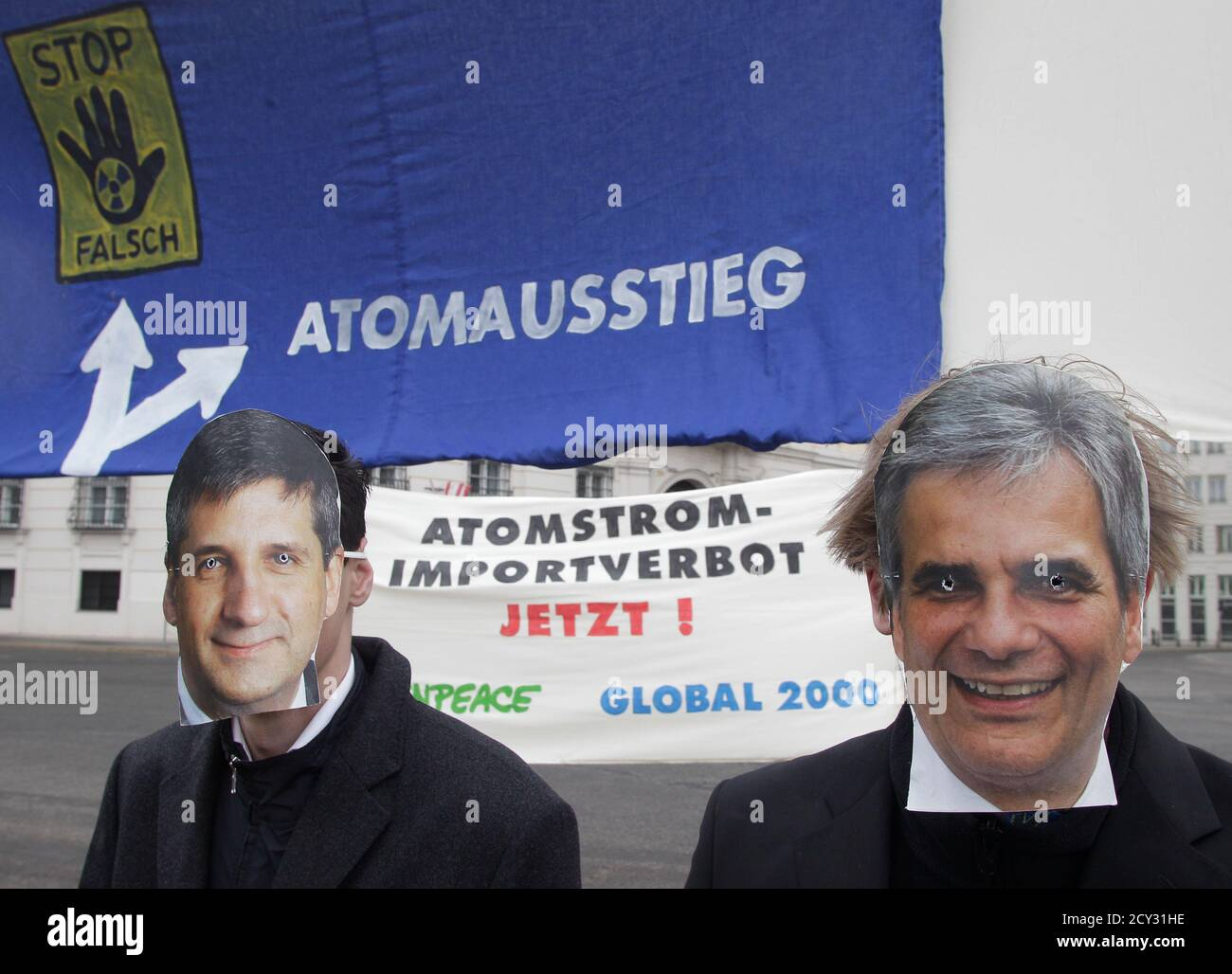 Members of Global 2000 , wearing masks of Austrian Chancellor Werner Faymann (R) and Foreign Minister Michael Spindelegger, protest for a nuclear phaseout ahead of an energy summit in front of the Federal Chancellery of the Republic of Austria in Vienna April 16, 2012. REUTERS/Leonhard Foeger  (AUSTRIA - Tags: POLITICS CIVIL UNREST) Stock Photo