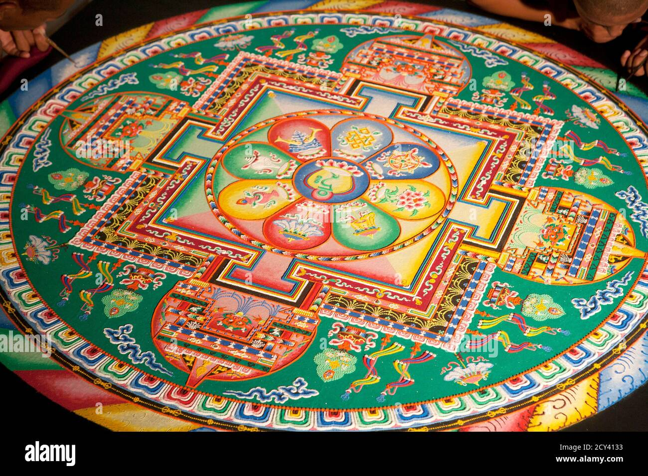 Tibetan monks work on a sand mandala during the First Tibetan Cultural Maya meeting in the Riviera Maya at Playa del Carmen September 11, 2011. The inaugural meeting aims to encourage the exchange of knowledge between these two ancient cultures and to share values related to the preservation of life and respect for nature. REUTERS/Victor Ruiz Garcia (MEXICO - Tags: RELIGION) Stock Photo
