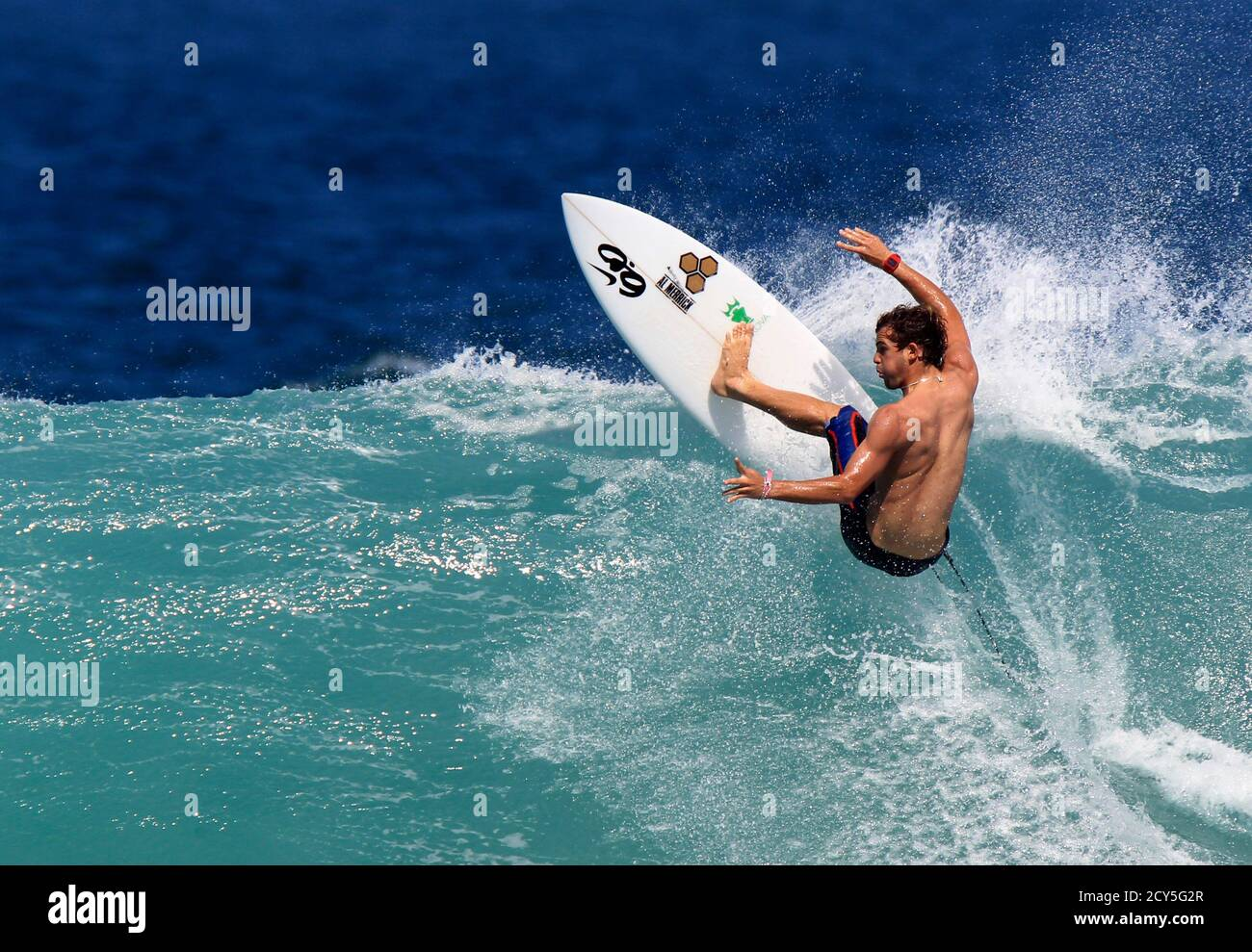Alejo Muniz of Brazil surfs a wave during a training session for the men's Association of Surfing Professionals (ASP) Billabong Rio Pro championship at Barra da Tijuca beach in Rio de Janeiro May 11, 2011. After monitoring conditions throughout the morning, event organizers have called competition off for the competition on Wednesday due to six foot (2 meters) closeout waves at the main event site of Barra da Tijuca beach. Organizers will reconvene tomorrow morning at 7 am local time to assess conditions.  REUTERS/Sergio Moraes (BRAZIL - Tags: SPORT)  FOR BEST QUALITY IMAGE ALSO SEE: GM1E96R1T Stock Photo