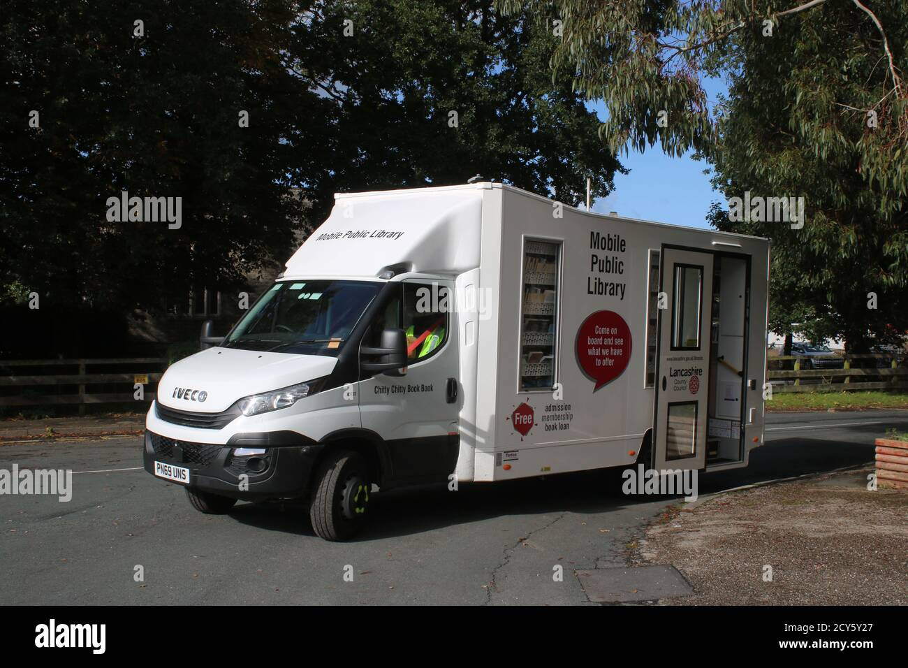 White Iveco van in use as a Mobile Public Library by Lancashire County Council seen parked on Fluke Hall Lane in Pilling, Preston October 2020. Stock Photo