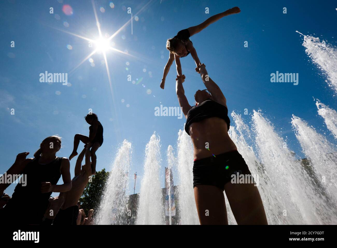 Belgian gymnasts rehearse in a fountain on the second day of the 2011 World Gymnaestrada in Lausanne July 11, 2011. More than 20,000 participants from around the world will take part in gymnastic performances over seven days at the non-competitive event.  REUTERS/Valentin Flauraud (SWITZERLAND - Tags: SPORT GYMNASTICS) Stock Photo