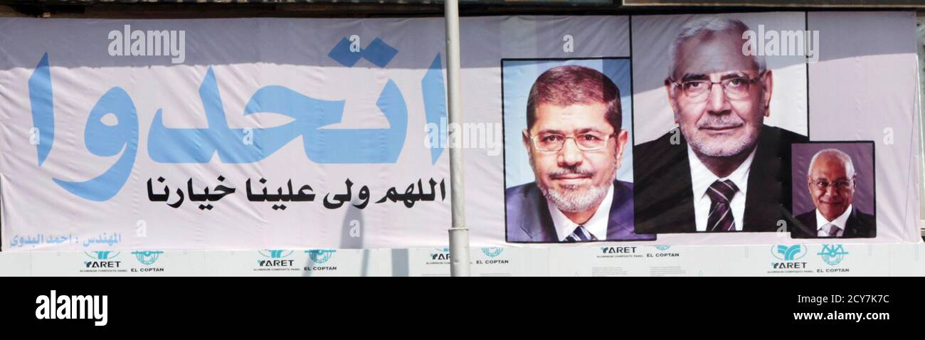 "A banner with Egyptian Islamic presidential candidates (from L) Mohamed Mursi, Abdel Moneim Abol Fotouh and Mohamed Selim al-Awa is seen in Cairo May 10, 2012. Voting starts on May 23-24 in the election to choose a new president after Hosni Mubarak was turfed out of office last year. The sign reads, ""Be United, Please, Allah choose good for us"".      REUTERS/Amr Abdallah Dalsh    (EGYPT - Tags: POLITICS ELECTIONS) Stock Photo"