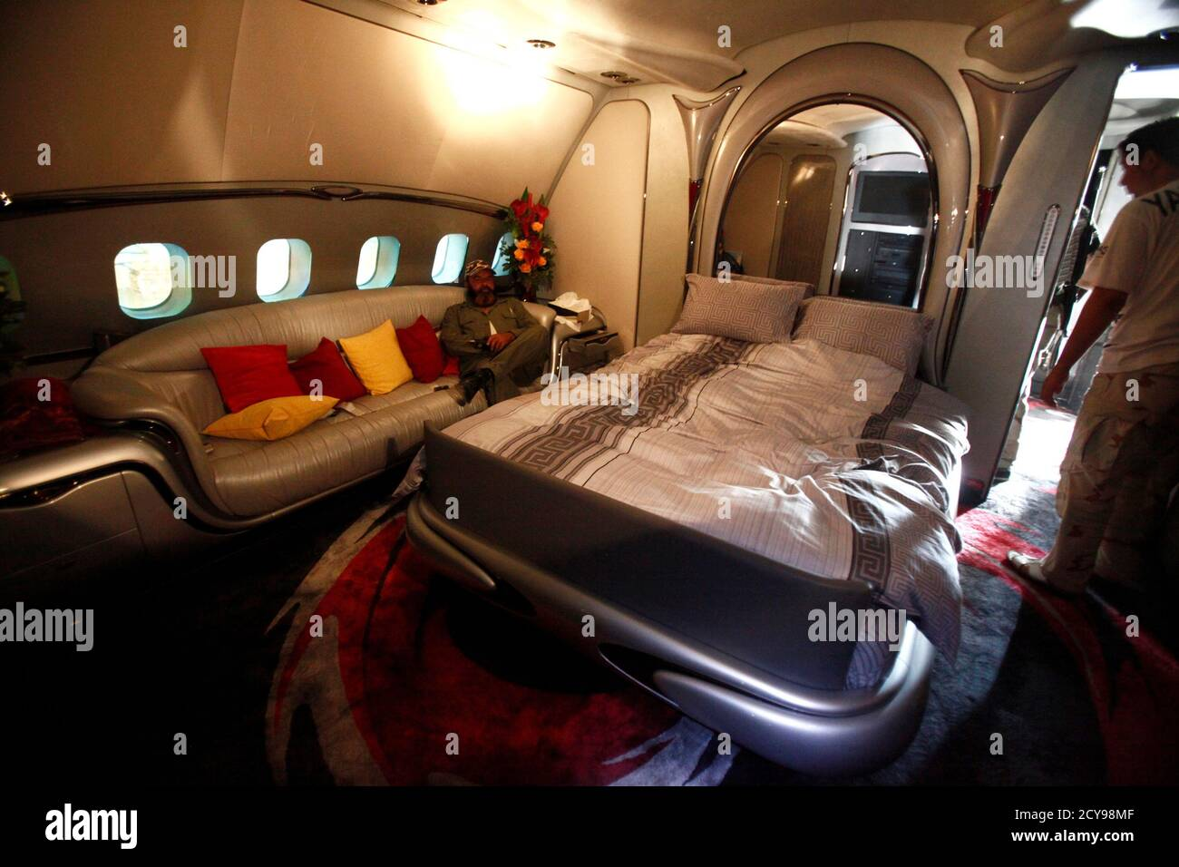 A Libyan Rebel Fighter Sits In A Bedroom Of Muammar Gaddafi S Private Plane At The International Airport In Tripoli In An August 28 2011 File Photo The Secretive Sale Of A Private