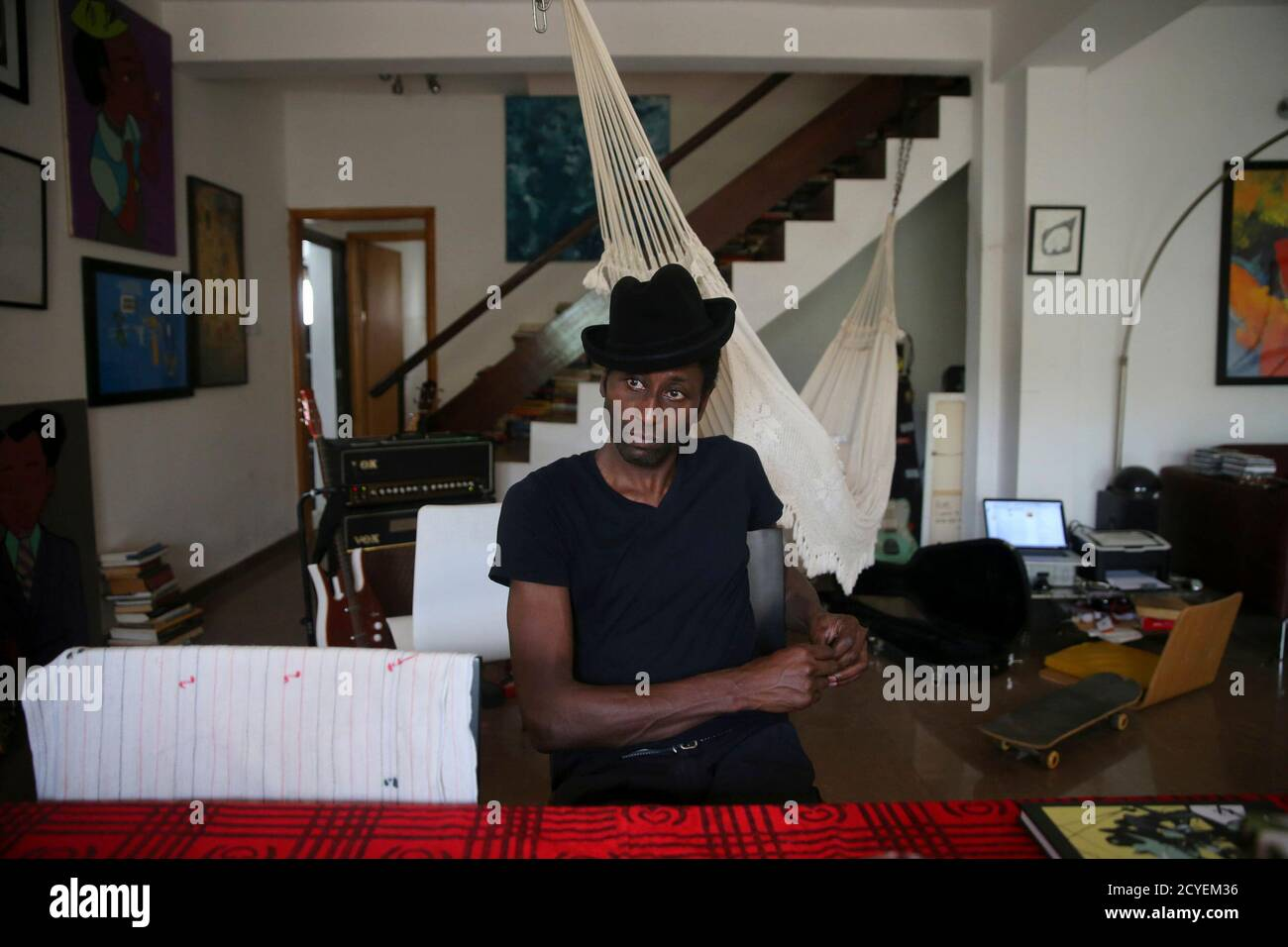 Nigerian Musician Keziah Jones Sits In His Living Room During An Interview With Reuters At His Home In Lagos February 25 2014 A New Superhero Is Fighting For Freedom Justice And The