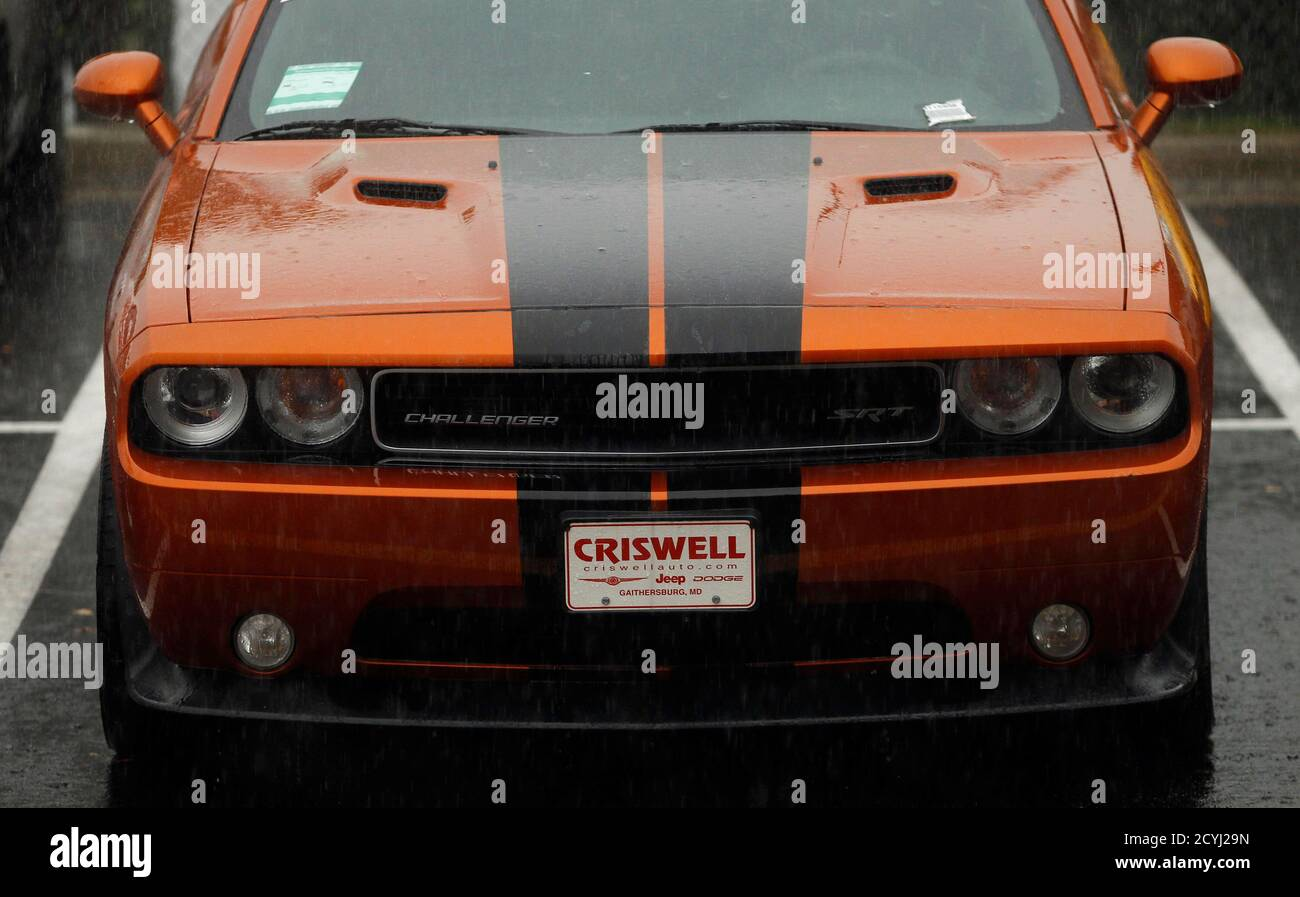 A Dodge Challenger Is Shown At The Criswell Chrysler Dodge Jeep Fiat Ram Truck Dealership In