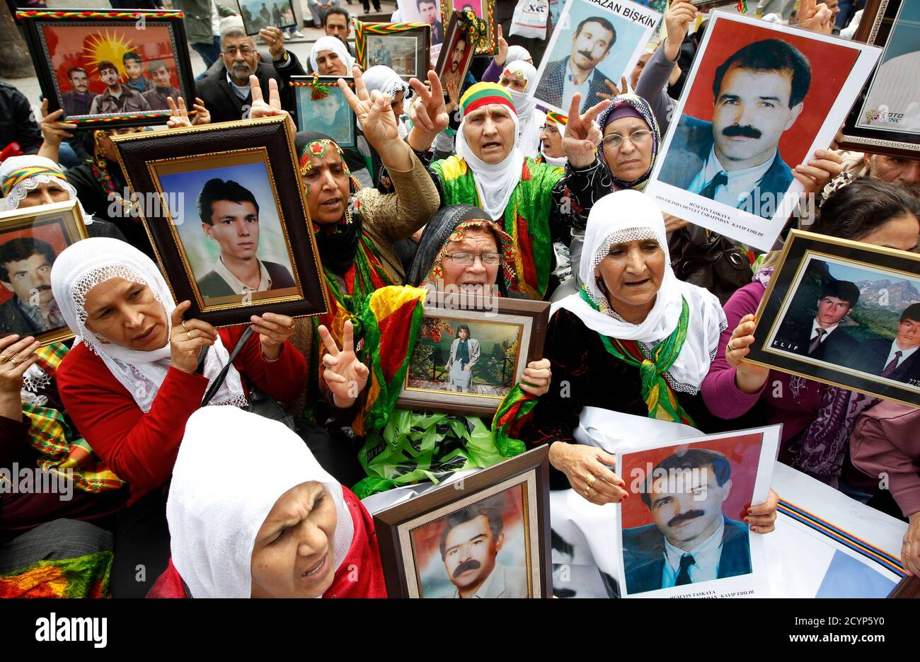 Turkish Kurdish women hold pictures of their loved ones who were killed in clashes between Kurdistan Workers Party (PKK) guerrillas and Turkish security forces, during a demonstration in central Istanbul May 18, 2011. More than 40,000 people have been killed in a separatist conflict in southeast Turkey since the Kurdistan Workers Party (PKK) took up arms against the state in 1984. REUTERS/Murad Sezer (TURKEY - Tags: POLITICS CIVIL UNREST IMAGES OF THE DAY) Stock Photo