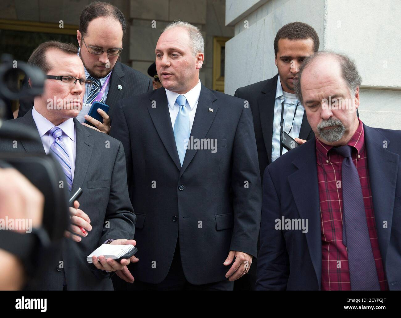 Newly elected House Majority Whip Steve Scalise (R-LA) (C) speaks to reporters as he walks to the Capitol in Washington June 19, 2014. House of Representatives Republicans on Thursday chose an ally of Speaker John Boehner for the number 2 job in the chamber and, in a victory for the party's conservative wing, elevated Southern lawmaker Scalise to a leadership role. REUTERS/Joshua Roberts (UNITED STATES - Tags: POLITICS ELECTIONS) Stock Photo