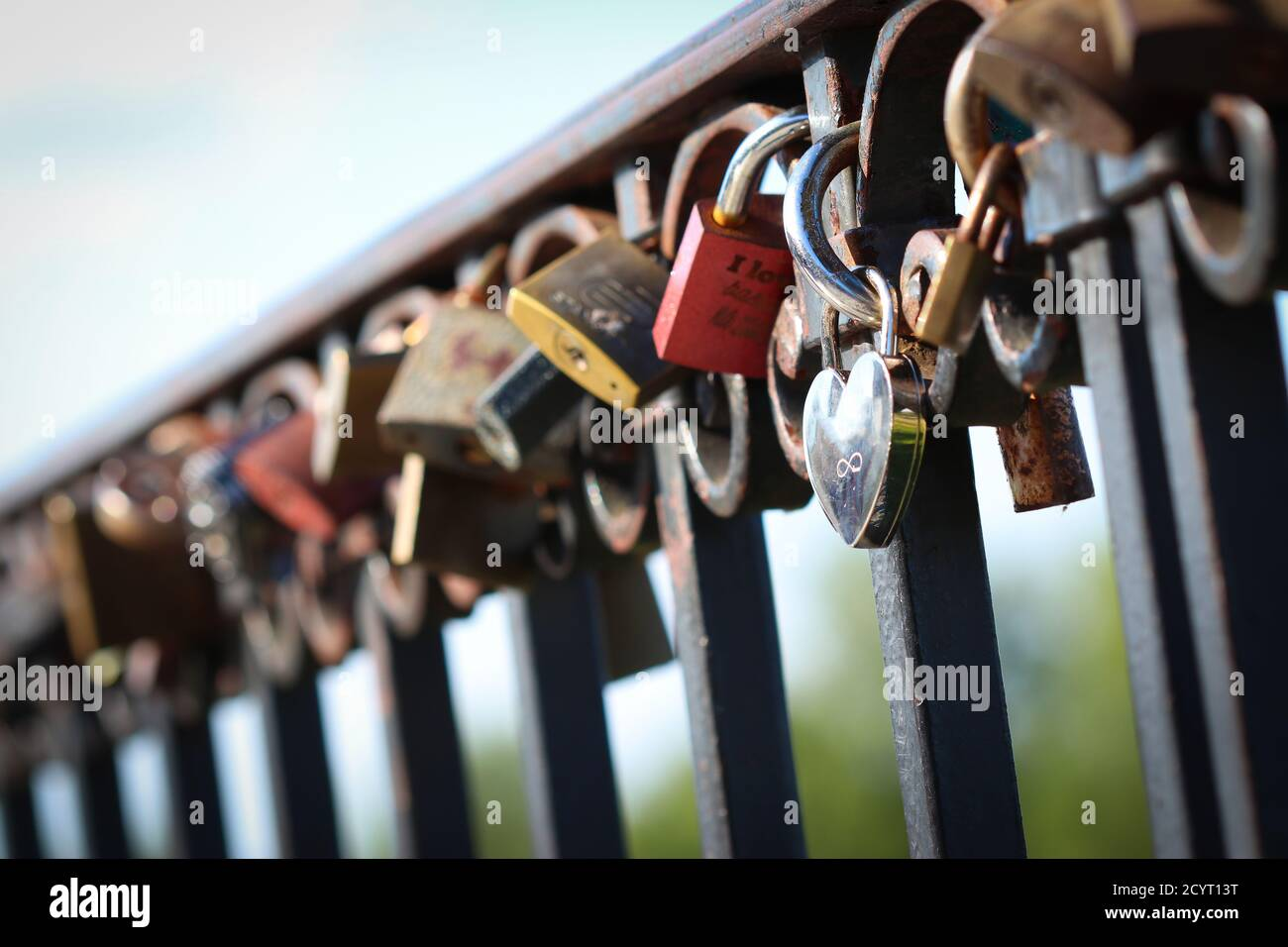 Love padlocks attached to the railing in Warsaw, Poland Stock Photo