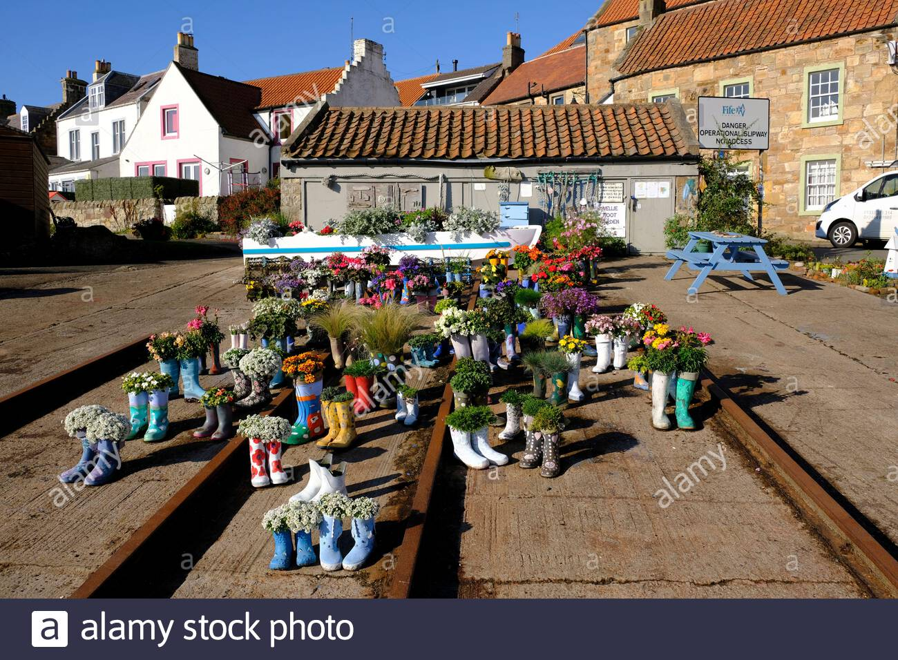 St Monan's, Scotland, UK. 2nd Oct 2020. Fine sunny weather at the Welly Boot Garden in St Monan's, Fife. The welly boot garden started out as part of the village's strategy to win Beautiful Fife and Beautiful Scotland awards and is now a visitor attraction in its own right.  Credit: Craig Brown/Alamy Live News Stock Photo