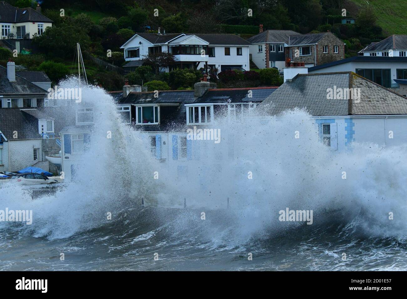 Portmellon, Cornwall. 2nd October 2020. UK Weather. Huge Storm force Waves batter houses on the front at Portmellon in Cornwall friday afternoon. Picture Credit Robert Timoney/Alamy/Live/News Stock Photo