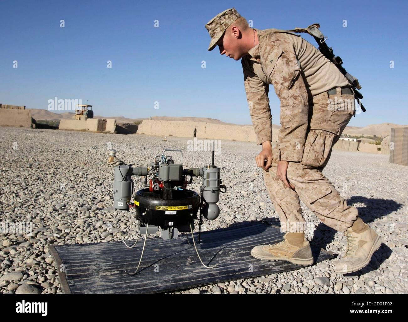 U.S. Marine Lance Corporal Paxton Force, of Fox Co, 2nd Battalion, 7th Marines Regiment checks T-Hawk, a surveillance drone camera at the Landing Zone of Combat Outpost Musa Qal-Ah in Helmand province, southwestern Afghanistan November 5, 2012. REUTERS/Erik De Castro  (AFGHANISTAN - Tags: MILITARY POLITICS CIVIL UNREST) Stock Photo