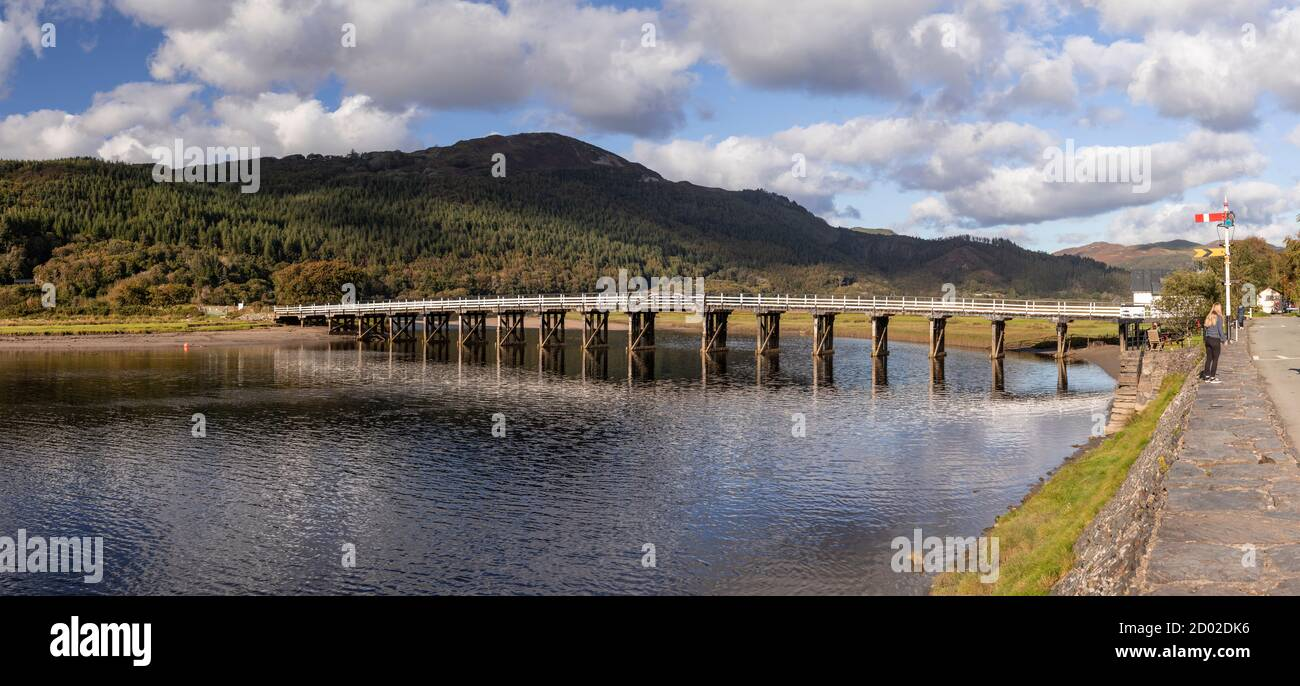 Panoramic view of old wooden toll bridge at Penmaenpool, North Wales Stock Photo