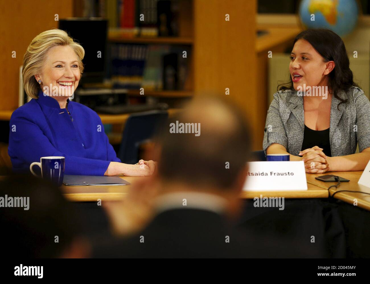 Former U.S. Secretary of State Hillary Clinton talks with 9th grade student Betsaida Frausto during a roundtable of young Nevadans discussing immigration, as she campaigns for the 2016 Democratic presidential nomination, at Rancho High School in Las Vegas, Nevada May 5, 2015.  REUTERS/Mike Blake Stock Photo