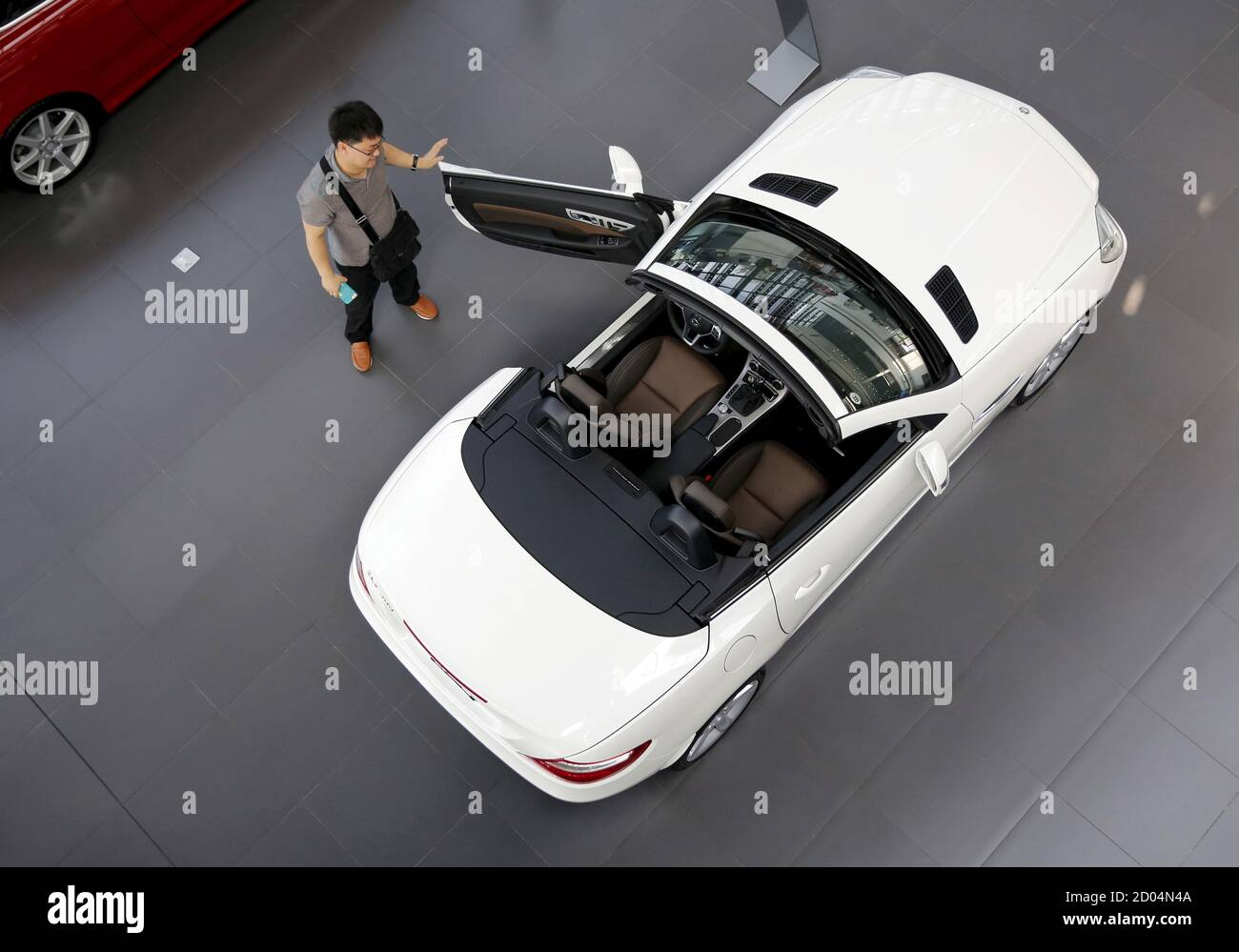Kang Zhilong Looks Around Mercedes Benz S Slk 200 At Its Dealer Shop In Beijing China July 13 2015 Prices For German Luxury Cars In China Are Tumbling As The Country S Stock Market Sell Off