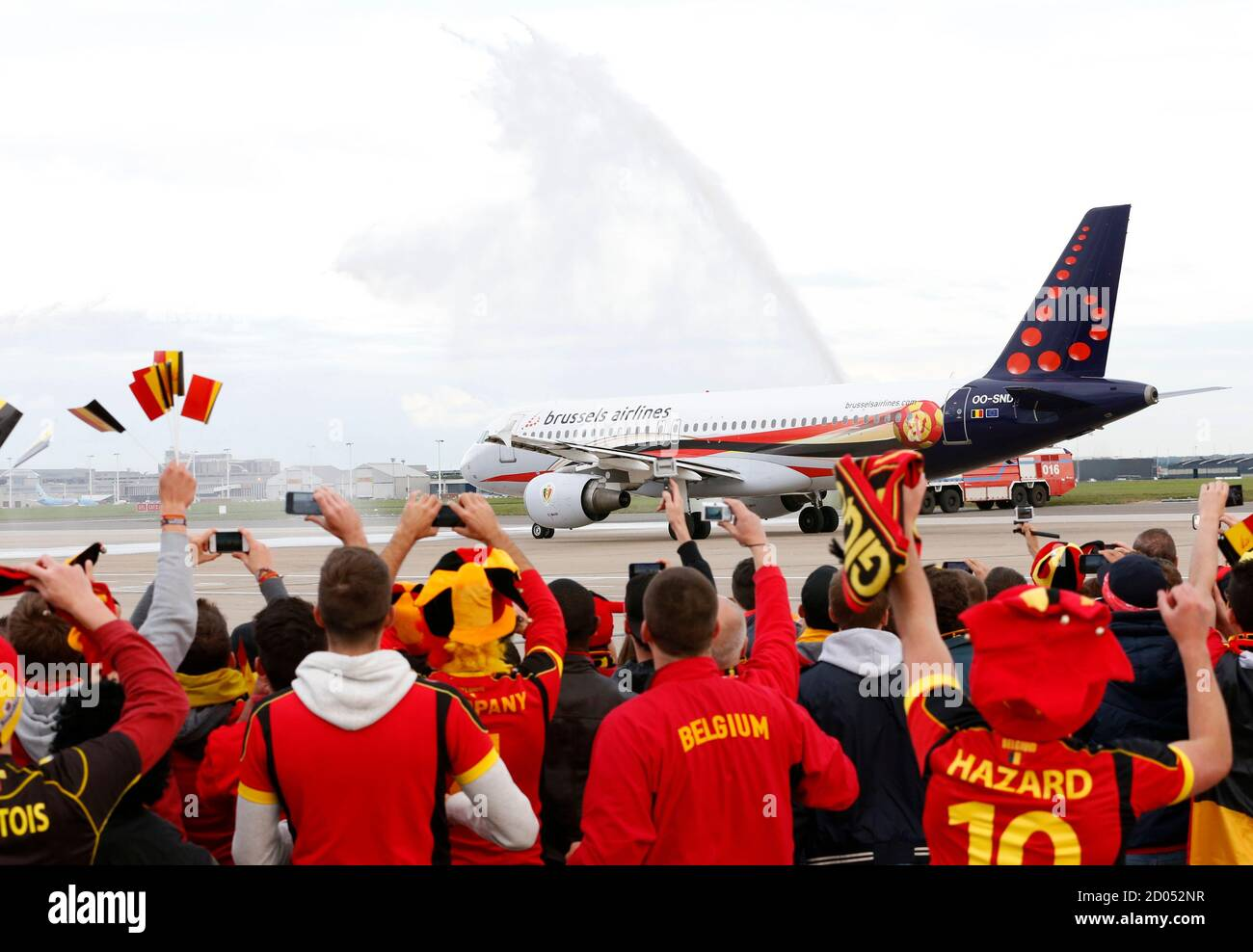 A Brussels Airline Plane With The Belgian Soccer Team On Board Is Sprayed With Water Before Their Departure To Zagreb As Supporters Of The National Squad Gather On The Tarmac Of Brussels