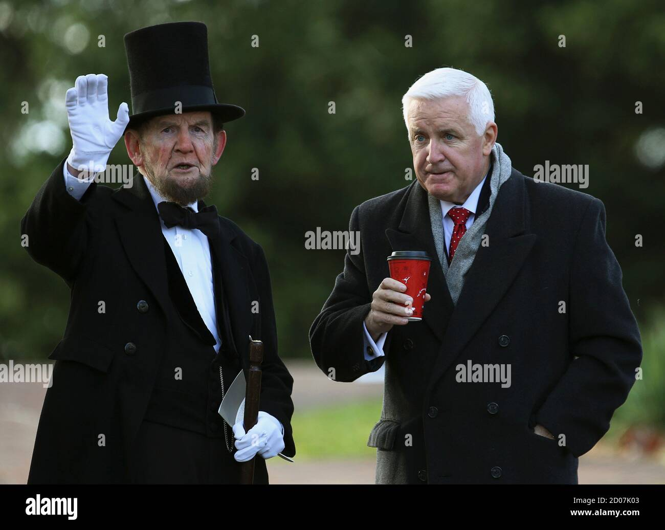 James Getty (L), portraying U.S. President Abraham Lincoln, chats with Pennsylvania Republican Governor Tom Corbett (R) before delivering the Gettysburg Address at the Gettysburg National Cemetery in Pennsylvania November 19, 2013.  Lincoln travelled to Gettysburg in 1863 to deliver a few concluding remarks at a formal dedication. Today marks the 150th anniversary of  Lincoln's famous two-minute speech.  REUTERS/Gary Cameron  (UNITED STATES - Tags: ANNIVERSARY POLITICS) Stock Photo