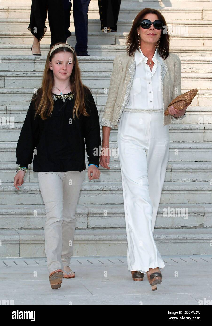 princess-caroline-of-hanover-r-and-her-daughter-alexandra-arrive-for-the-2011-2012-cruise-collection-show-for-french-fashion-house-chanel-at-the-cap-dantibes-on-the-french-riviera-may-9-2011-reutersvincent-kessler-france-tags-fashion-royals-2D07W2W.jpg