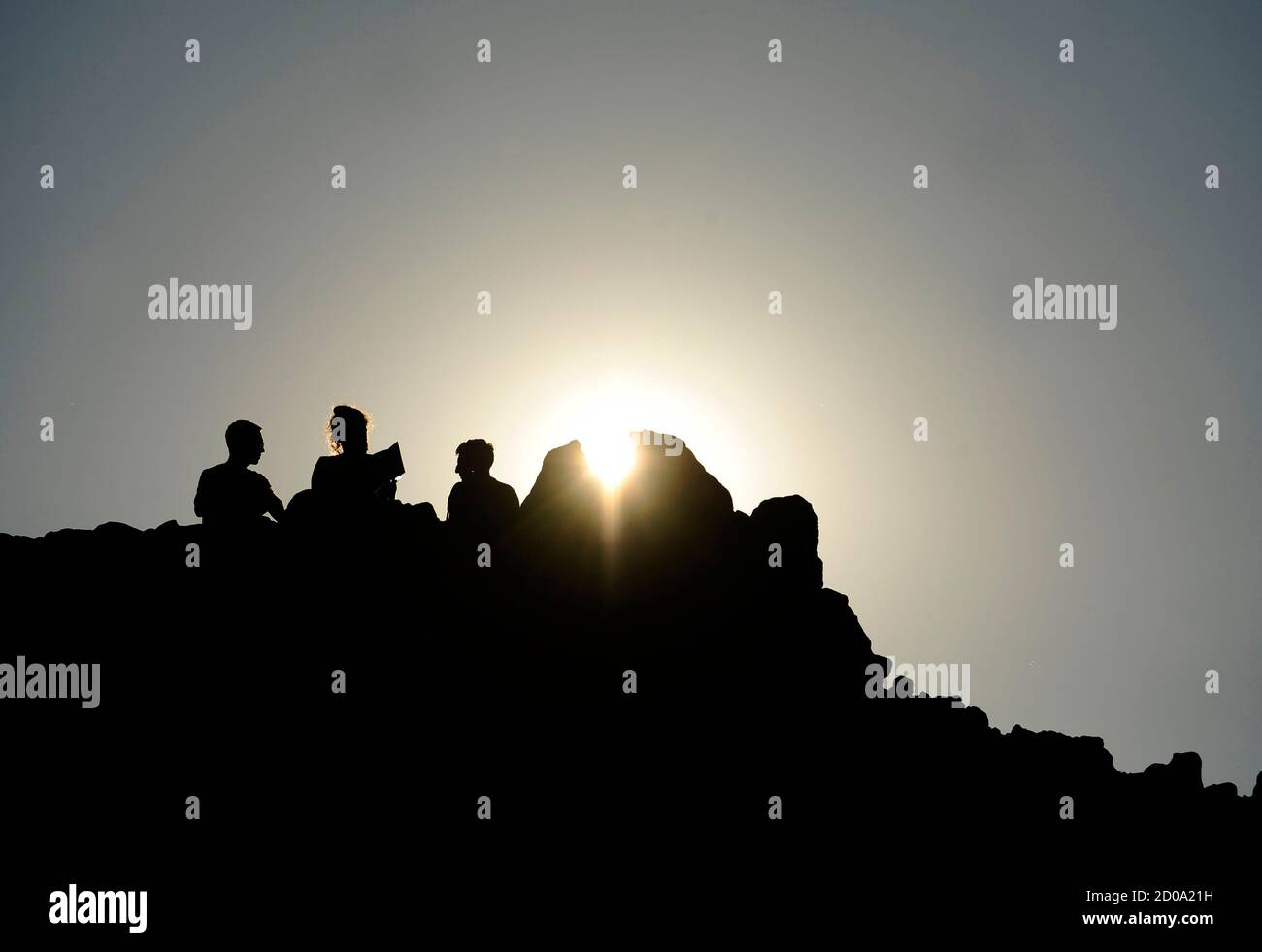 Macedonians celebrate the summer solstice at the marker of the Kokino megalithic observatory in Kumanovo June 21, 2013. The 3,800 years old observatory was discovered in 2001 in the north-western town of Kumanovo 70 km (43 miles) north from capital Skopje and is ranked as the fourth oldest observatory in the world after Egypt's Abu Simbel, Britain's Stonehenge and Cambodia's Angkor Wat according to NASA.  REUTERS/Ognen Teofilovski (MACEDONIA - Tags: SOCIETY ENVIRONMENT TRAVEL) Stock Photo