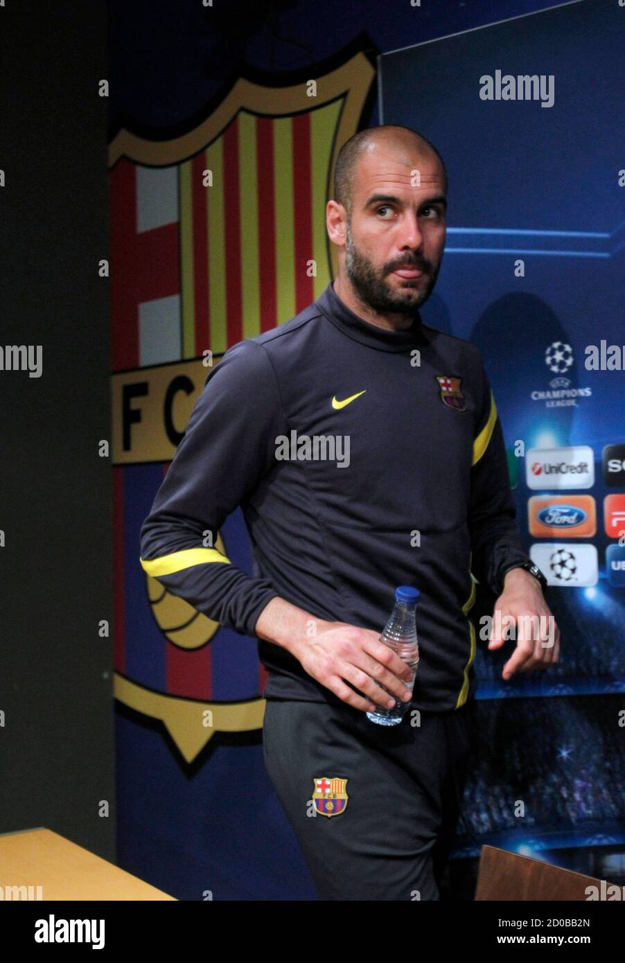 Barcelona's coach Pep Guardiola arrives for a news conference at Camp Nou  stadium in Barcelona, April 2, 2012. Barcelona will play against AC Milan  in their Champions League soccer match second leg
