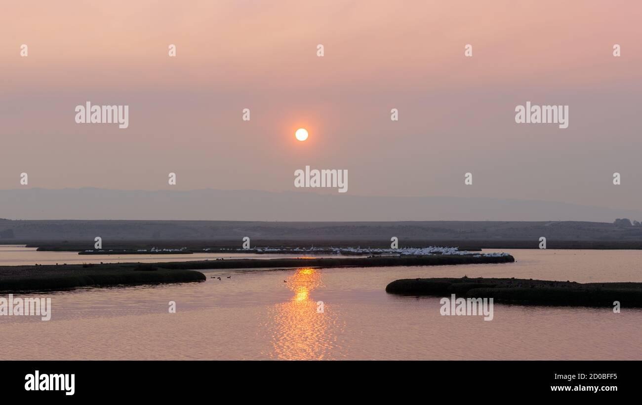 Sun setting behind smoky skies during 2020 California Wildfires Stock Photo