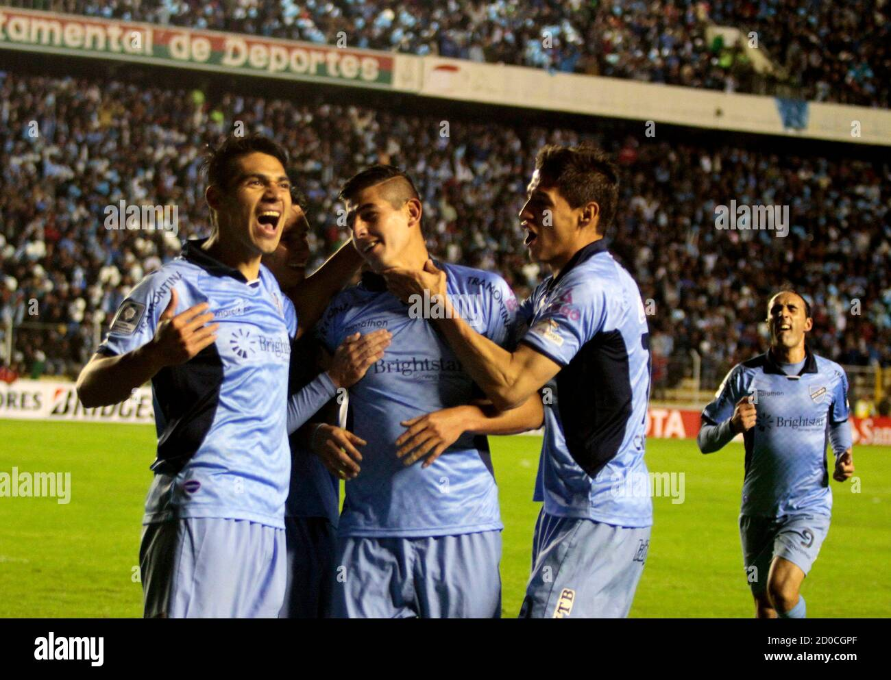 Ronald Eguino (C) of Boliva's Bolivar celebrates with teammates Luis Gutierrez (L) and Nelson Cabrera after scoring a goal against Mexico's Leon during their Copa Libertadores soccer match in La Paz, April 22, 2014. REUTERS/Gaston Brito (BOLIVIA - Tags: SPORT SOCCER) Stock Photo