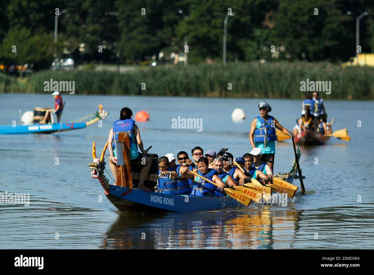 Competitors paddle during the 24th annual Hong Kong Dragon Boat Festival at Meadow Lake in the Queens borough of New York City, August 9, 2014.  REUTERS/Eduardo Munoz (UNITED STATES - Tags: SPORT SOCIETY) Stock Photo