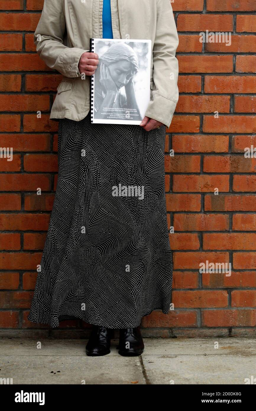 Tracy Deans, whose great uncle James McClelland died in the bombings of Claudy in 1972, stands for photographers with a copy of the report by the Police Ombudsman, Claudy, Northern Ireland August 24, 2010. The government, the police and the Catholic Church colluded to protect a priest suspected of involvement in a 1972 bombing in Northern Ireland that killed 9 people, a report said on Tuesday.The Police Ombudsman's eight-year probe revealed a cardinal was involved in moving Father James Chesney out of Northern Ireland, highlighting anew the way the Church hierarchy shielded priests from allega Stock Photo