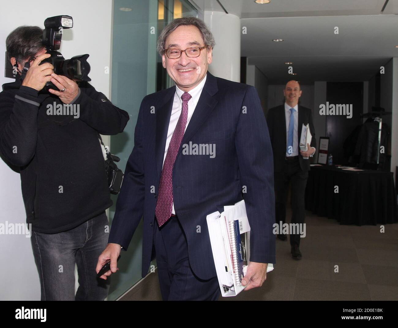 Michael Sabia, president and chief executive officer of Caisse de depot et placement du Quebec (CDP) walks to a press briefing for the release of their 2013 financial results in Montreal, February 26, 2014. REUTERS/Christinne Muschi (CANADA - Tags: BUSINESS) Stock Photo