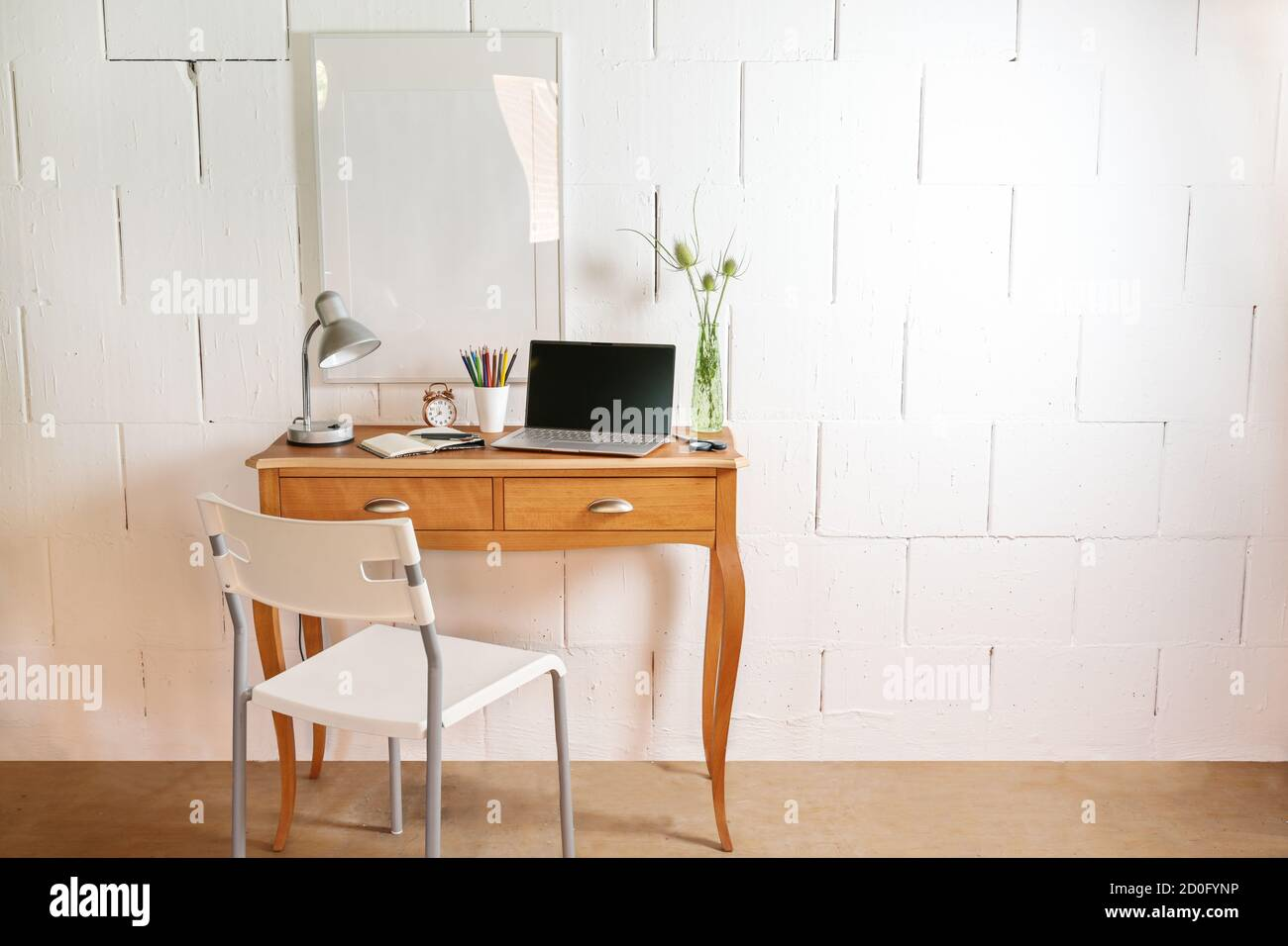 Small Wooden Table And Chair As A Tiny Place For A Home Office With Laptop Desk Lamp And Tools Against A Rough White Wall Copy Space Selected Focus Stock Photo Alamy