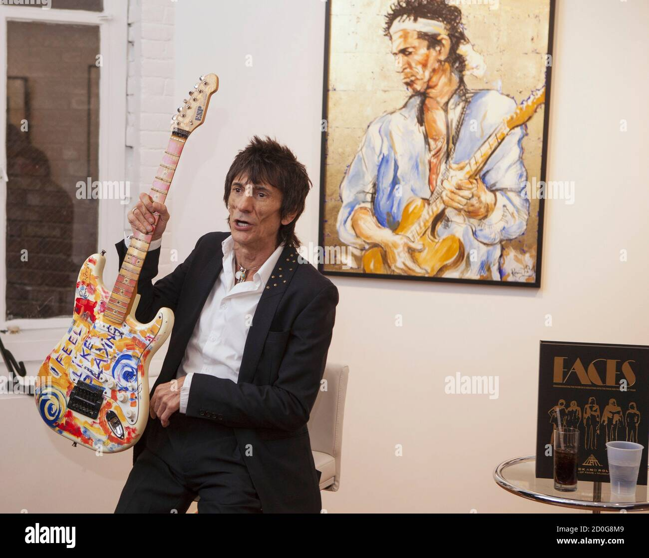 """Rolling Stones guitarist Ronnie Wood discusses his art during a news conference at his """"Faces, Time and Places"""" gallery show in New York April 9, 2012. The British guitarist known for his jamming skills with the bands such as """"The Faces"""" and """"Rolling Stones"""" along with his highly documented battles with alcoholism and drug abuse is also a trained visual artist. The exhibit titled """"Faces, Time and Places"""" showcases Wood's finest work made over the period of four decades comprised of original paintings and sketches that are up for sale. REUTERS/Lucas Jackson (UNITED STATES - Tags: ENTERTAINMENT) Stock Photo"""