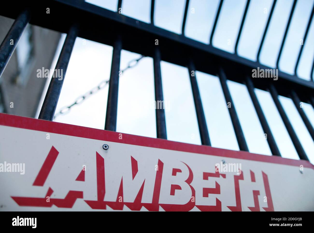 A sign for a Lambeth council service hangs on the railings of a car park in south London November 22, 2013. Three women enslaved for 30 years have been rescued from a house in London including one who has spent her entire life in domestic servitude, police said on Thursday. Police attended an address in Lambeth, the Metropolitan Police said in a statement.   REUTERS/Andrew Winning (BRITAIN - Tags: CRIME LAW SOCIETY) Stock Photo