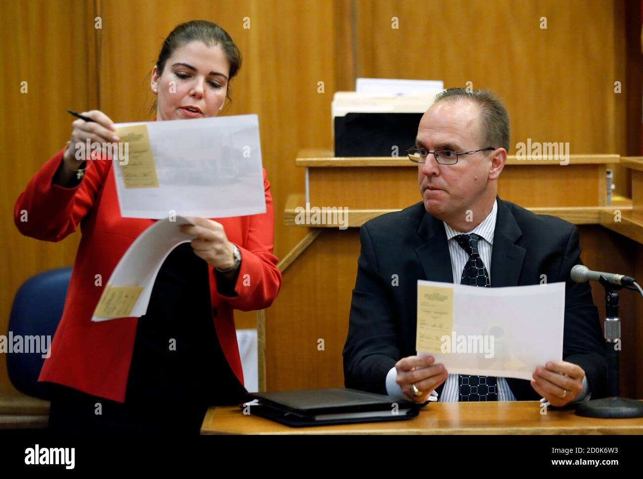 Prosecutor Marie Mato L Shows Evidence To City Of Miami Lt Carlos Castellanos During A Bail