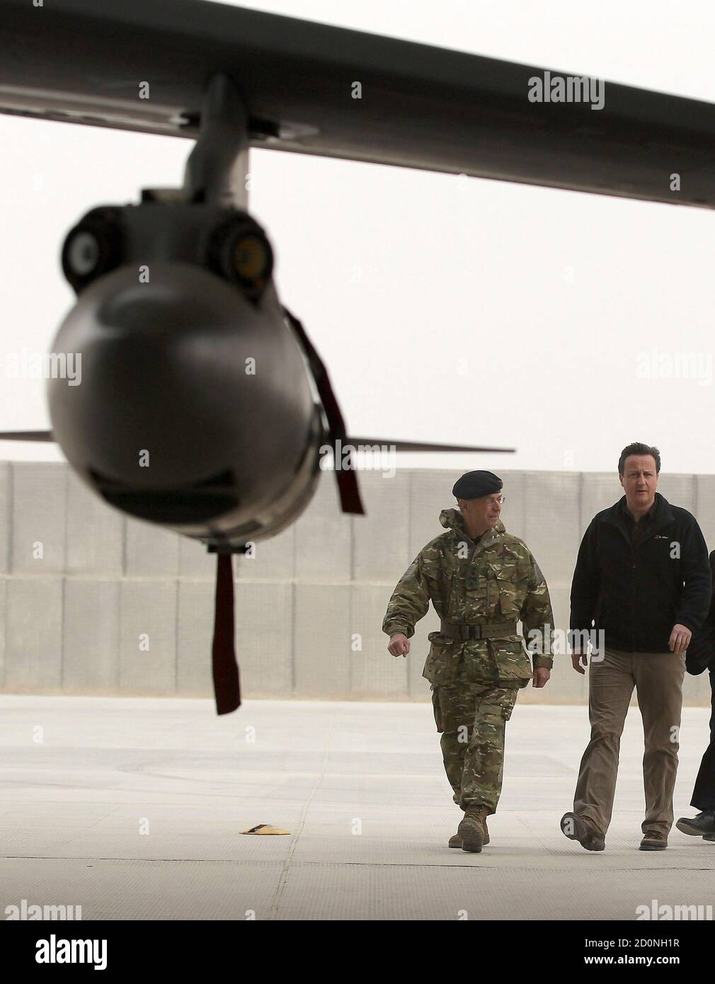 Britain's Prime Minister David Cameron views a Tornado fighter jet based with 12 (B) squadron at Kandahar airfield during a visit to meet British forces in Afghanistan December 20, 2011.   REUTERS/Jeff J Mitchell/Pool      (AFGHANISTAN - Tags: MILITARY POLITICS CONFLICT) Stock Photo
