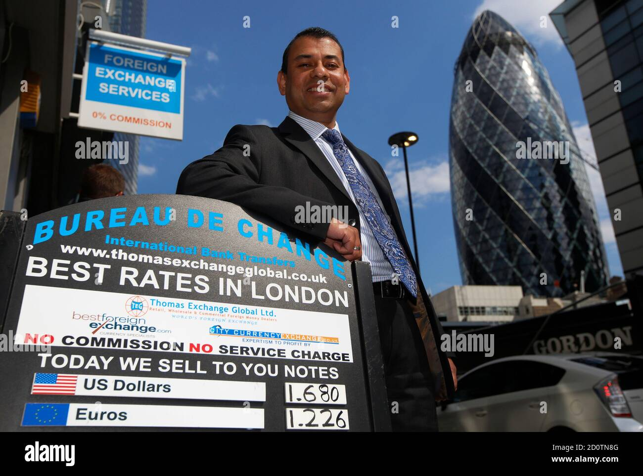 Director Sakthi Ariaratnam poses outside a branch of Thomas Exchange Global foreign exchange in the City of London July 1, 2014. From a small, white-washed basement close to London?s Liverpool Street station, Ariaratnam is beating banks at what you would have thought was their own game - and it is relatively easy. On a recent Tuesday morning in the heart of London's City financial district, Sakthi's firm Best FX would sell you 124 euros for 100 British pounds. Less than 20 metres along the street, the world's third biggest trader of foreign currencies, Barclays, would only give you 118. Photog Stock Photo