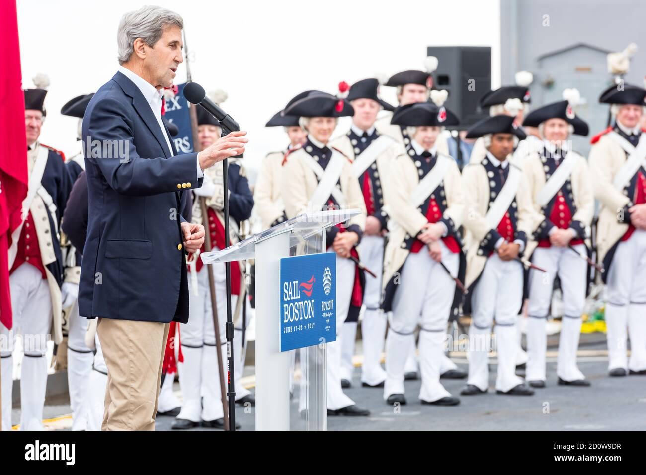 Boston, Massachusetts. 13th June, 2017. Former Secretary of State John Kerry speaking at Sail Boston. Photographed from the USS Whidbey Island. Stock Photo