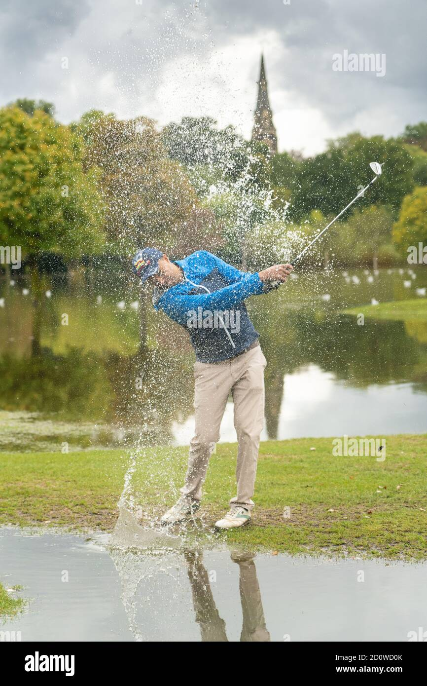 UK Weather. London, UK. Saturday, October 3, 2020. Oscar Brown plays a shot on Brent Valley golf course in Hanwell, London, which flooded the day after heavy rain caused the river Brent to flood. Photo: Roger Garfield/Alamy Live News Stock Photo