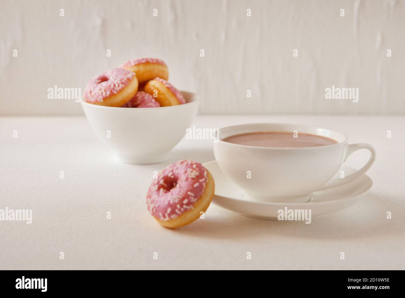Mug Of Hot Cocoa And Donuts On White Background Tasty Pink Donuts And Hot Cacao Cup Sweet Breakfast Stock Photo Alamy