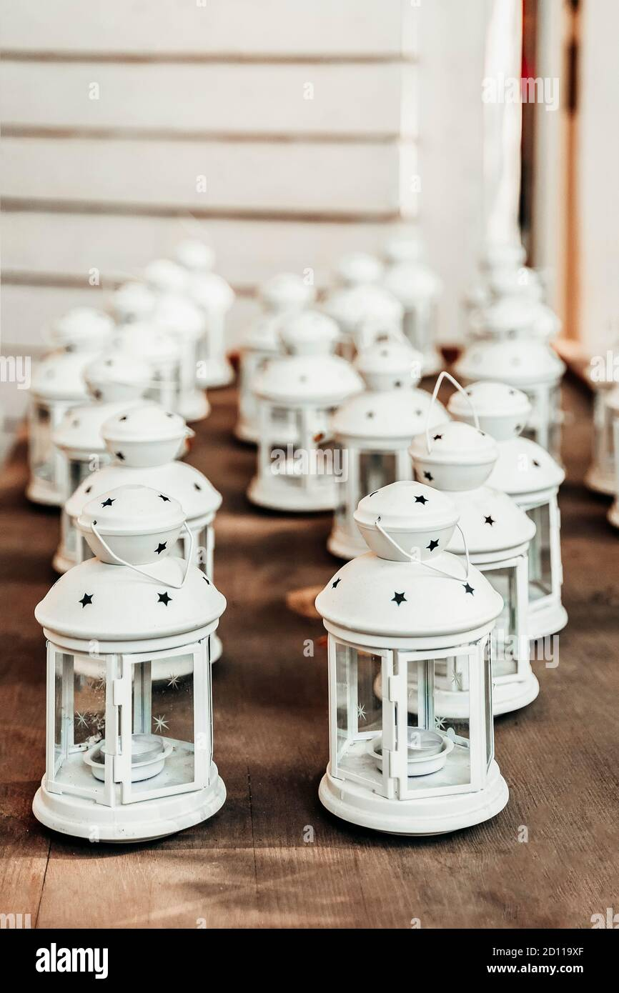 Old White Lanterns With Candles Inside On Wooden Table Preparing For Christmas Cozy Decor Stock Photo Alamy