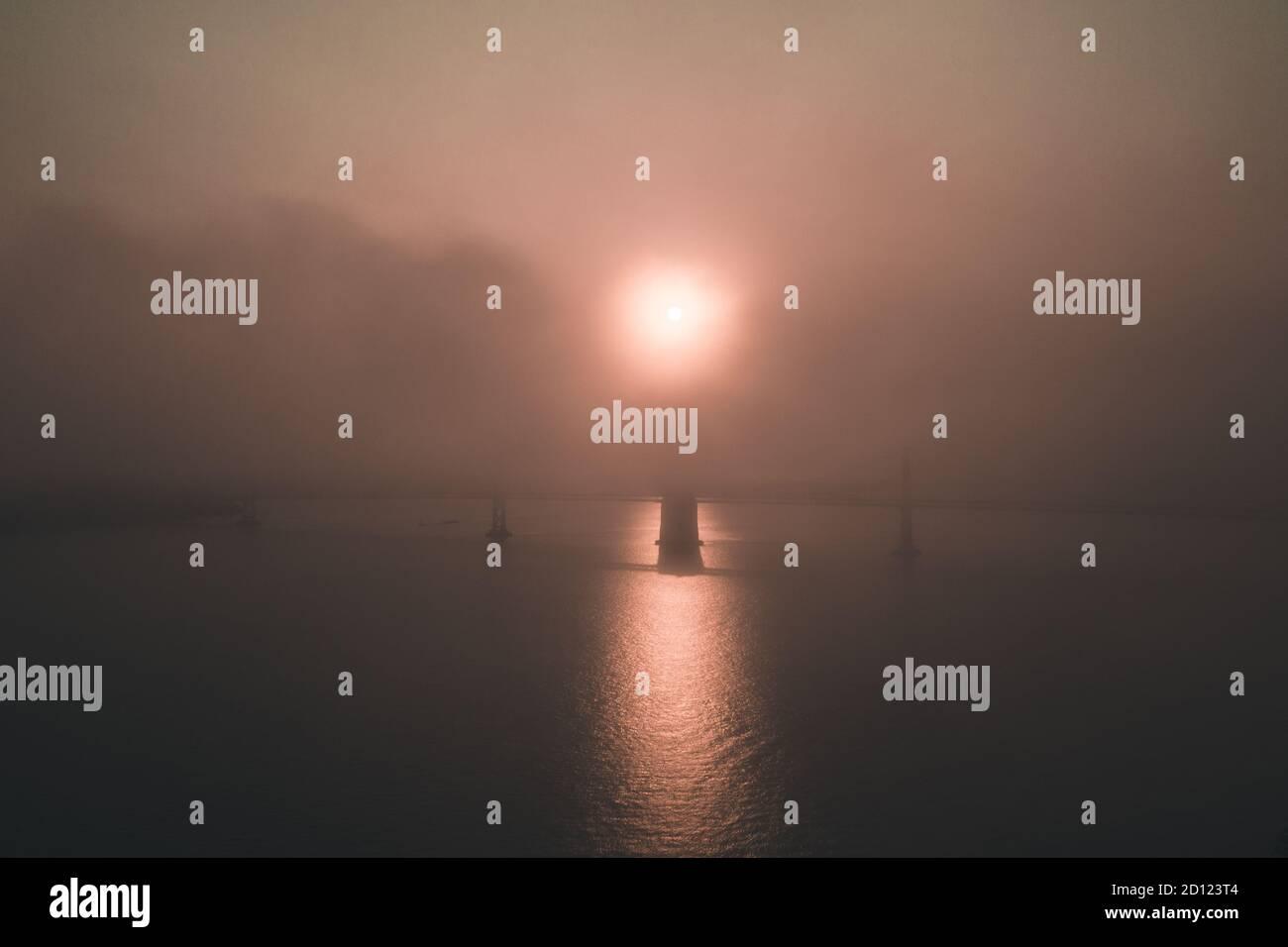 Gloomy apocalyptic sunrise over Bay Bridge in San Francisco Stock Photo
