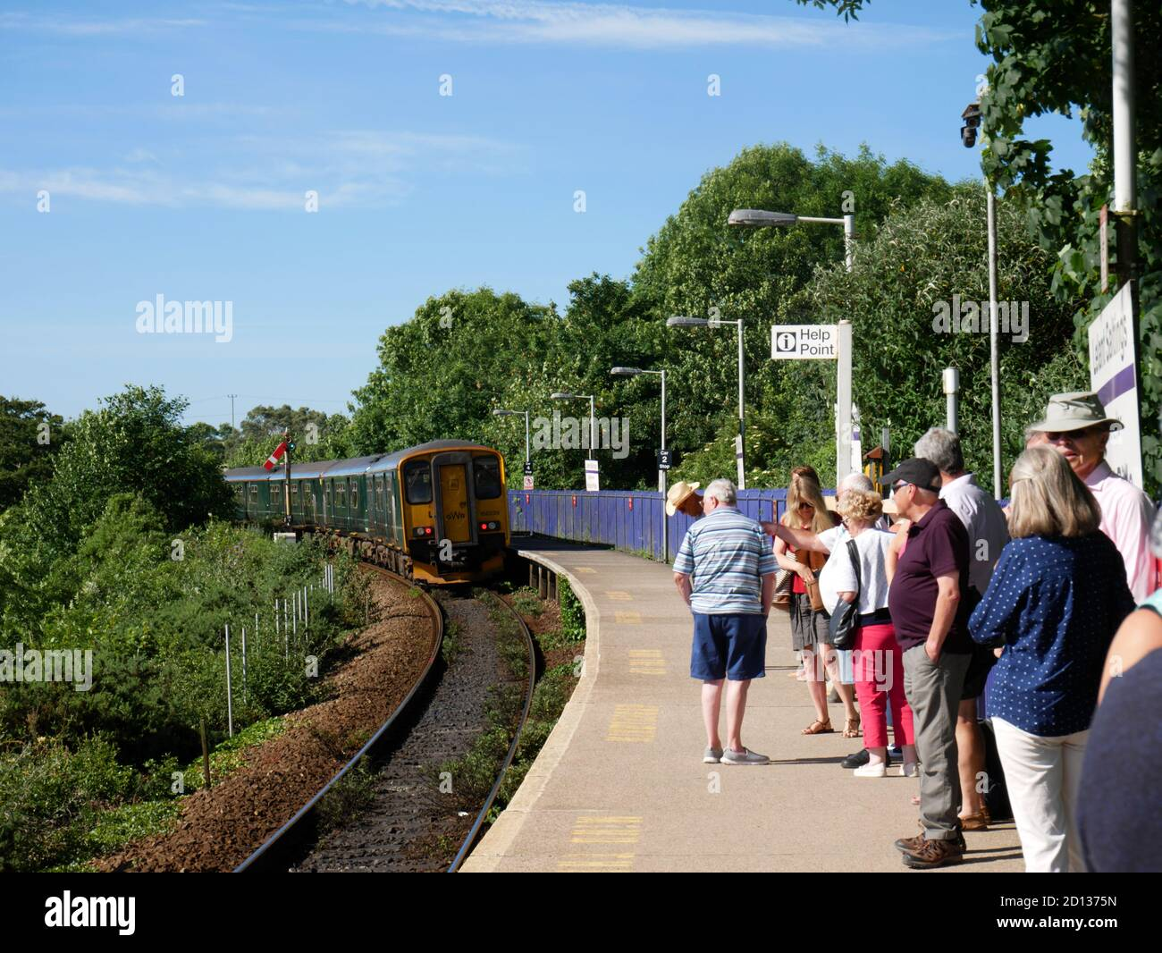 A train departs from Lelant Saltings on the St Ives to St Erth branchline, Cornwall. Stock Photo