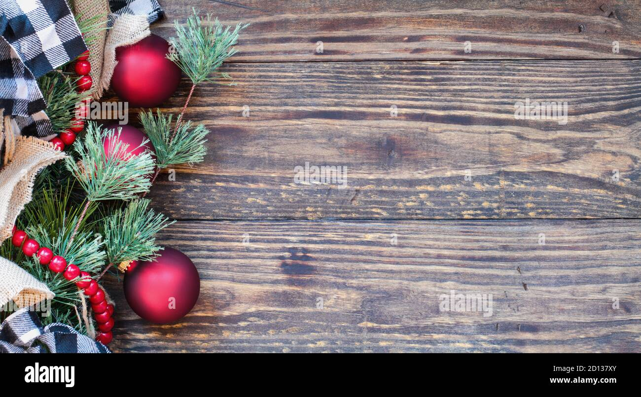 Christmas Background With Holiday Trimmings Of Pine Tree Branches Ornaments Black And White Buffalo Check Ribbon Burlap And Red Bead Garland Top Stock Photo Alamy