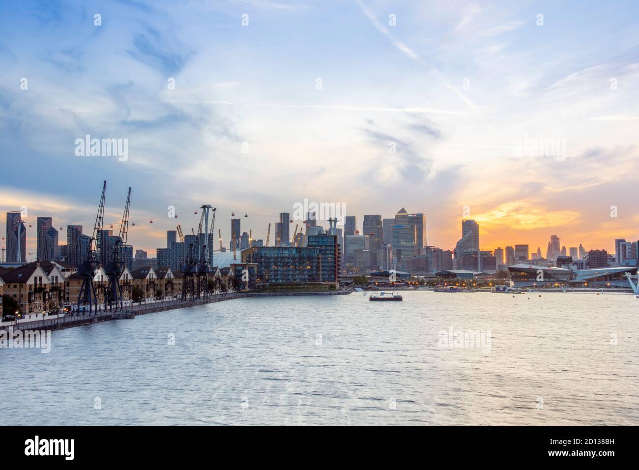 UK, London, Docklands. Central Business District from East London, showing Royal Victoria Docks, O2 Millennium Dome & the Emirates Cable Car Stock Photo