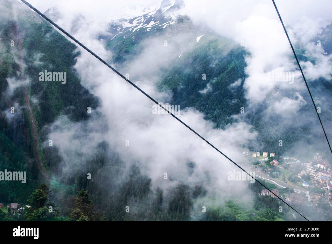cable car on a mountain slope cable cars running up and down Stock Photo