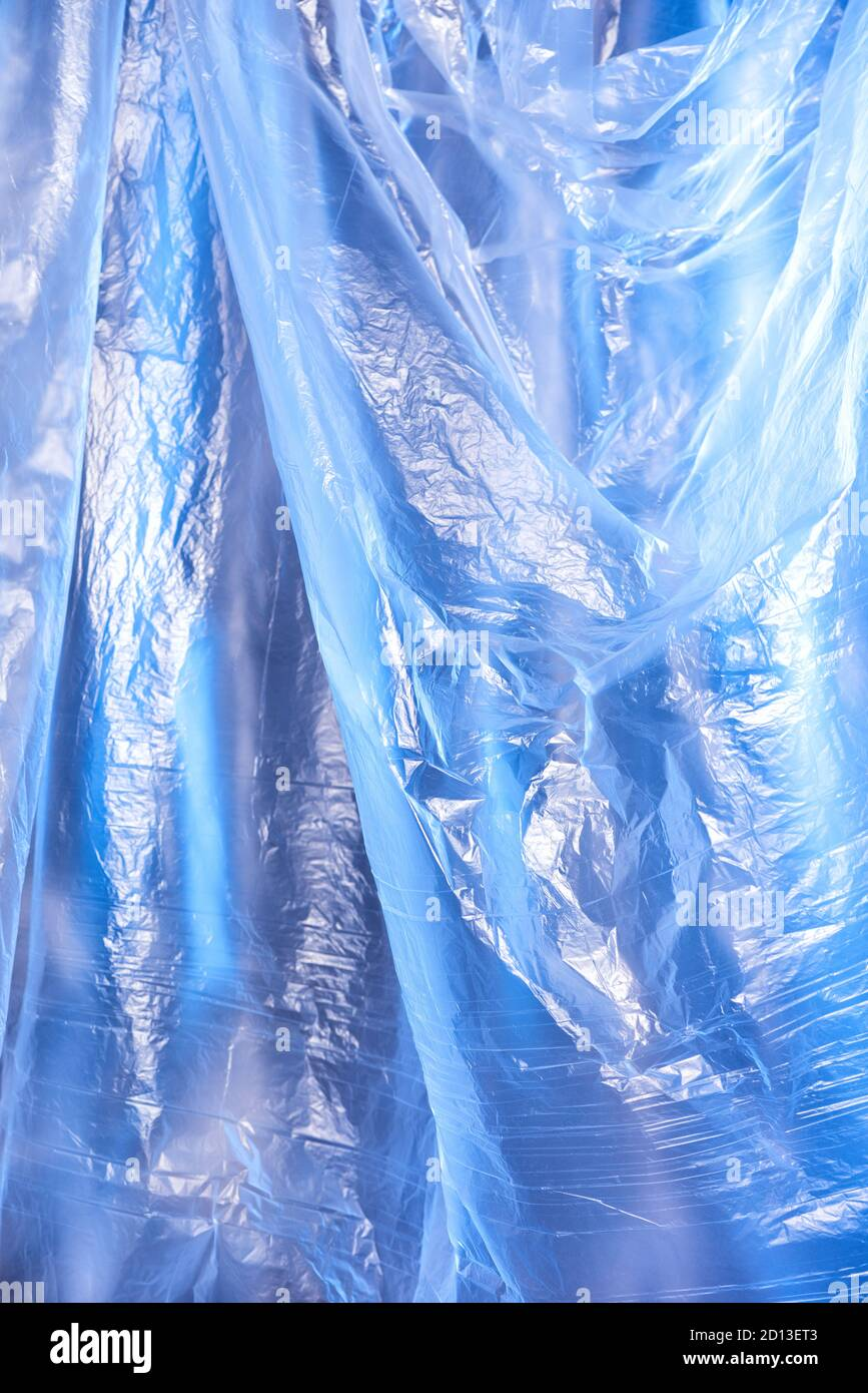 Abstract blue background of colorful textured holographic polyethylene Stock Photo