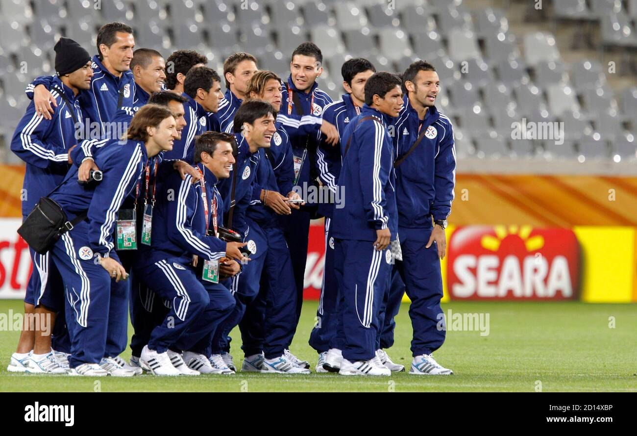 Paraguay's players pose for a group picture during a visit to the Green Point stadium in Cape Town June 13, 2010.  REUTERS/Carlos Barria (SOUTH AFRICA - Tags: SPORT SOCCER WORLD CUP) Stock Photo