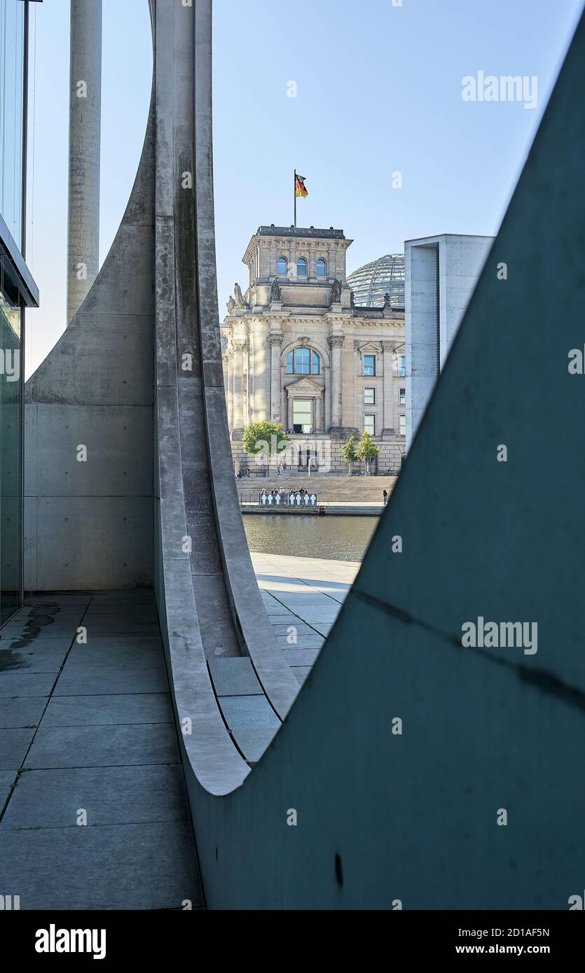 Part of the façade of the Marie Elisabeth Lüders Haus with the Reichstag building next to the river Spree in the background at the Berlin's government Stock Photo