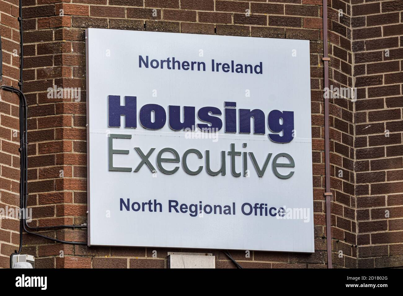 Derry, Northern Ireland- Sept 27, 2020: The sign for Northern Ireland Housing Executive in Derry. Stock Photo