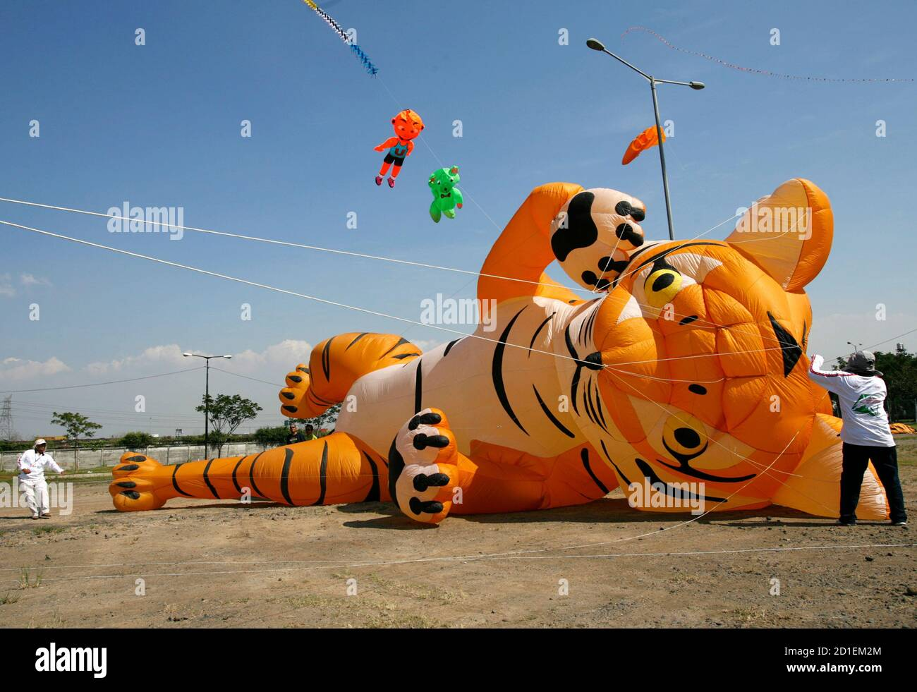 Malaysian participants prepare to fly their kite during the Jakarta International Kite Festival July 24, 2010. Participants from 15 provinces in Indonesia and nine countries, including Australia, Germany, Malaysia, Singapore, the Netherlands and Japan, joined the two-day festival.  REUTERS/Supri (INDONESIA - Tags: SOCIETY) Stock Photo